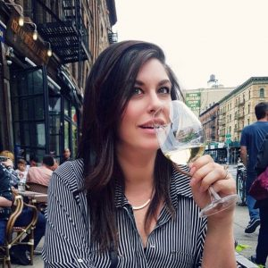Lonelle Sips wine on a patio