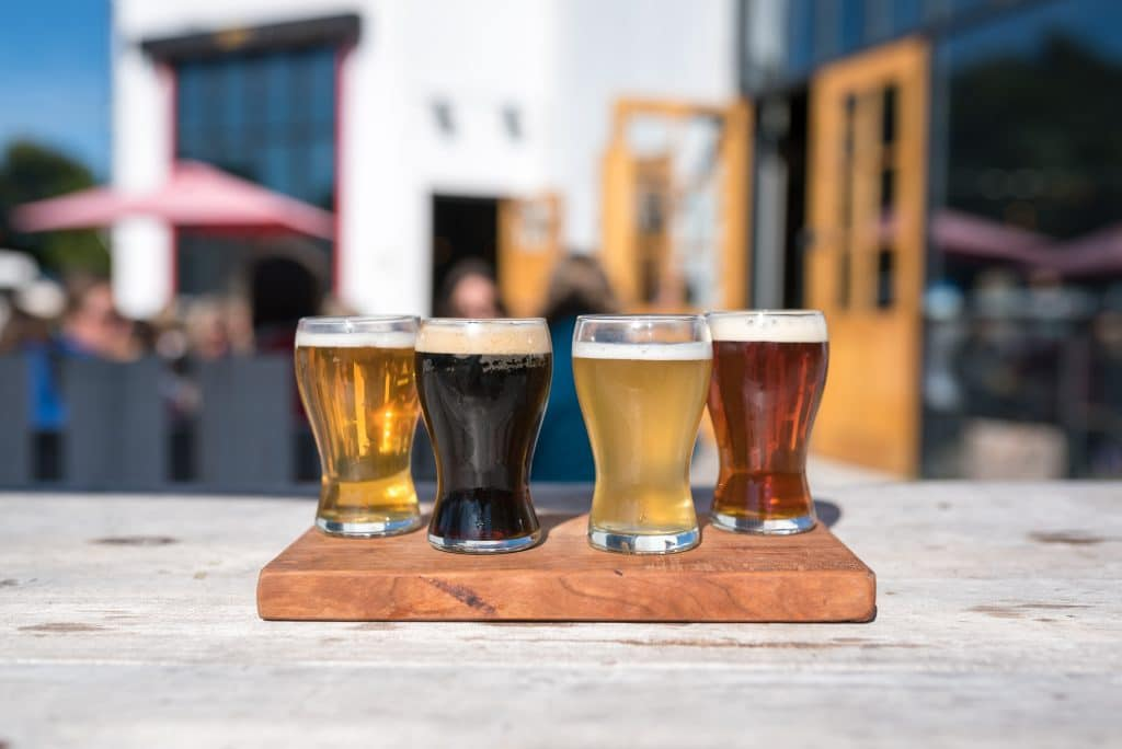 Midtown Brewery lineup of four types of their craft beers on the patio